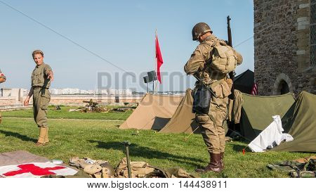 Us Soldiers Stand Guard In A Reconstituted Military Camp