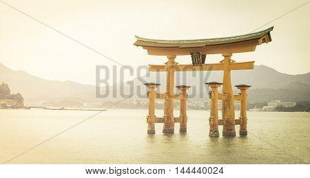 Miyajima Red Torii gate with mountain background