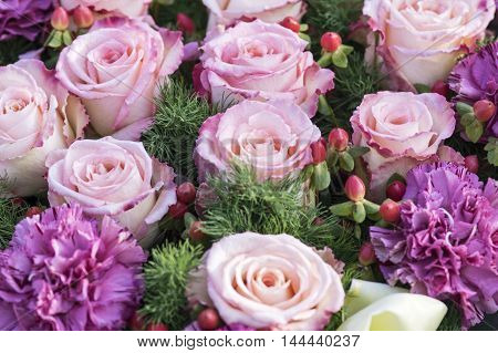 A elegant Bouquet of purple roses and carnations