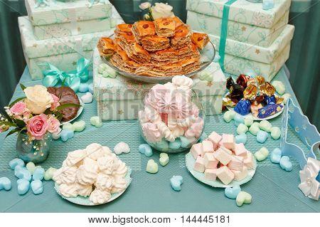 sweet buffet with pink marshmallow white marshmallow fondant
