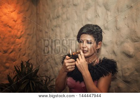 Attractive woman with a cigar abd black fur