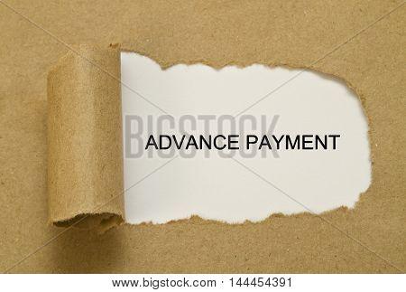 Advance payment written under torn paper .