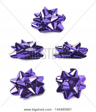 Decorational bow made of glossy violet tape, composition isolated over the white background, set of five different foreshortenings
