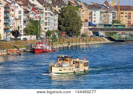 Basel, Switzerland - 27 August, 2016: the Rhine river and buildings along it, view from the Mittlere Bruecke bridge. Basel is a city in northwestern Switzerland on the Rhine river, situated where Swiss, German and French borders meet.
