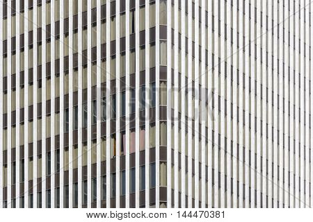 Telephoto shot side corner of tall condominium high rise building featuring architectural detail and design