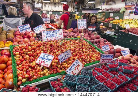 SEATTLE USA - JUNE 11 2016: High quality fresh fruits including local favorites Rainier cherries and blueberries are available at many fruit stands at the famous Pike Place Market.
