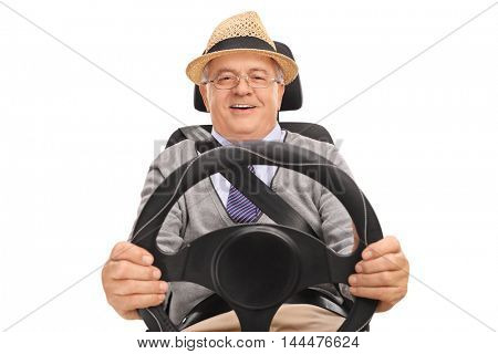 Smiling senior sitting on a car seat and driving isolated on white background