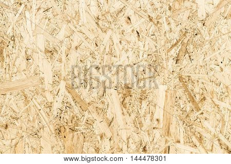 The texture of the surface of the OSB panel as a background.
