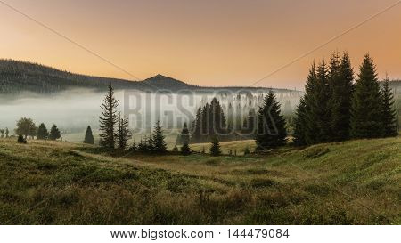 Amazing View on Lusen hill from Breznik in Sumava, colored skybefore sunrise.South Bohemia, 1.373m.