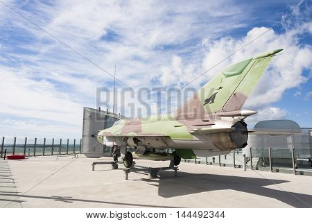 HELSINKI FINLAND - AUGUST 27 2016: Old fighter jet on a roof terrace in the city centre of Helsinki Finland on August 27 2016