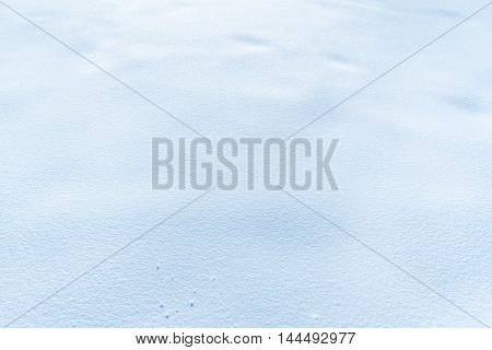 Snow background - Close-up image with the surface of a snow layer with great details and perfect as a winter background.