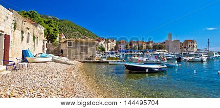 Komiza on Vis island beach and town panoramic view Dalmatia Croatia