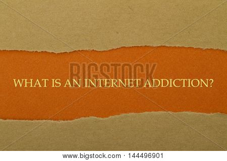 What is An Internet Addiction? question written under torn paper.