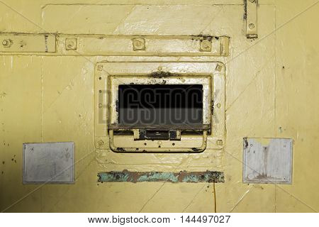 Adelaide, South Australia, Australia - August 14 2016: Open cell door hatch of a remand cell at the old historic Adelaide Gaol.