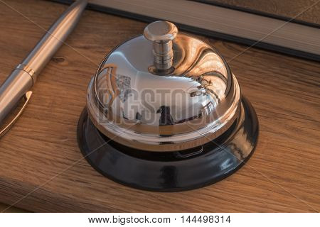 Hotel reception desk with a chrome service bell