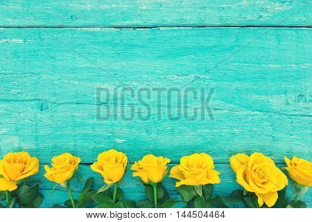 Frame Of Yellow Roses On Turquoise Rustic Wooden Background. Valentine's Day And Mother's Day Backgr