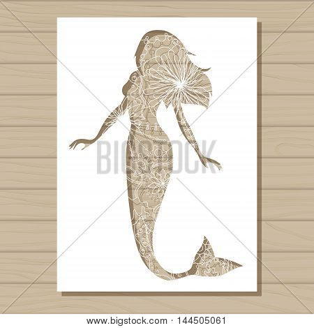 Vector stencil template of mermaid on wooden background