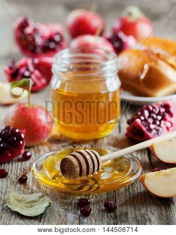 New Year Holiday Rosh Hashana traditional food: honey, apple, pomegranate and hala table set