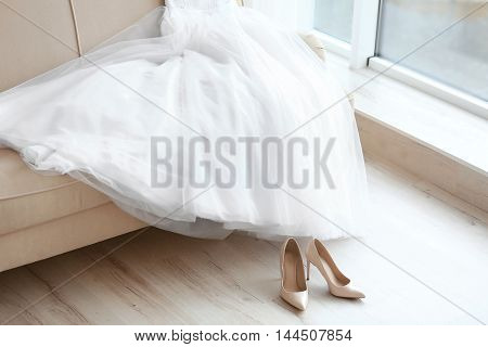 Bride's beautiful wedding gown and shoes