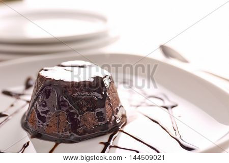 Chocolate fondant cake on the plate
