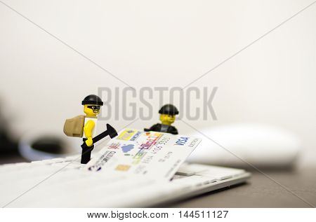 Orvieto, Italy - December 27th 2014: Team of computer hackers attacking credit card payment. Lego is a popular line of construction toys manufactured by the Lego Group