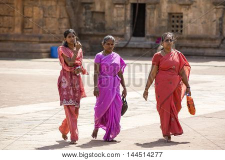 Thanjavur, Tamil Nadu, India - June 27, 2014. Tanjore temple in Tamil Nadu India Unesco building. Religious people around the temple.