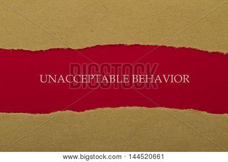 Unacceptable Behavior written under torn paper .