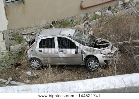 Daliyat al-Karmel, Israel-24 July, 2016 : car roll down after crushing the safety rail on the way to Daliyat al-Karmel