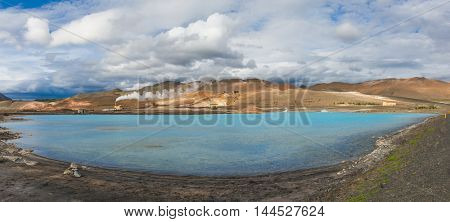 Blue water of the silica pool produced by a nearby geothermal plant. The lake is located near the lake Myvatn, Iceland.
