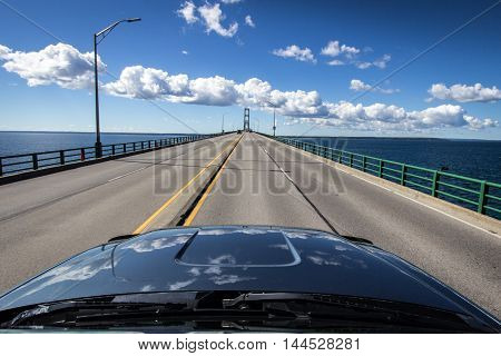Driving across the Mackinac Bridge in Michigan. The Mackinaw Bridge connects Michigan's Upper and Lower Peninsula. It is the largest suspension bridge in the Western Hemisphere. The bridge is part of Interstate 75.