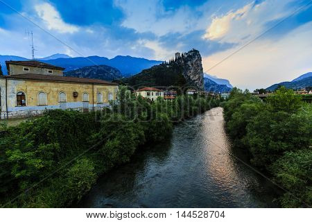 Views of the Arco river and castle in background. Arco, Trentino, Italy.