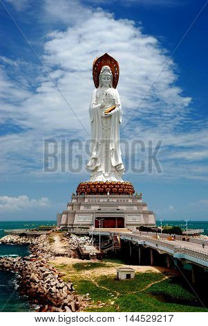 San Ya / Hainan China: Set on a man-made island in the sea a Guan Yin Chinese Buddhist Goddess of mercy is the 4th largest statue in the world *