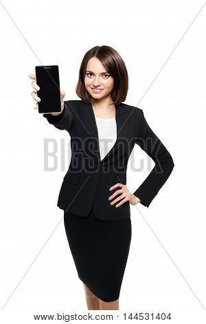 Business woman show blank card or mobile cell phone display on a white background. Focus on the hand