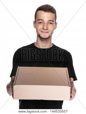 Delivery man holding a cardbox isolated on white background.