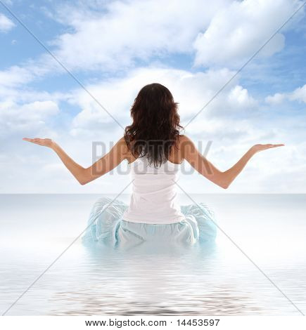 poster of Young fit brunette meditating isolated on white