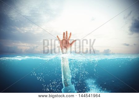 Businessman drowning in the sea and asks for help