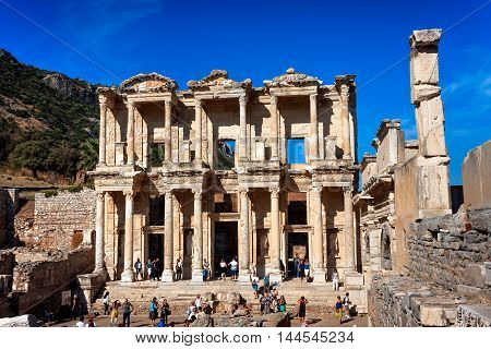 EPHESUS TURKEY - SEPTEMBER 30 2014: Library of Celsus in Efes full of tourists. Wide front view