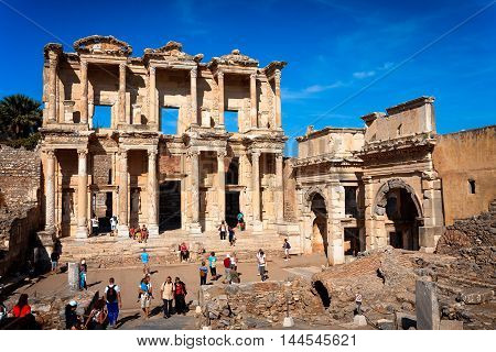 EPHESUS,TURKEY - SEPTEMBER 30, 2014: Tourists visiting Library of Celsus and Gate of Augustus in Efes