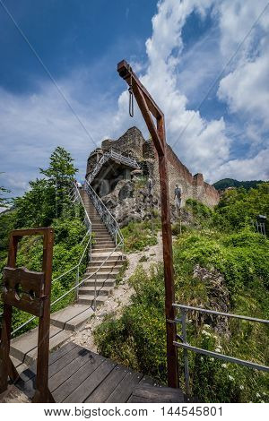 Gallows and guillotine in front of Ruined Poenari Castle on Mount Cetatea in Romania