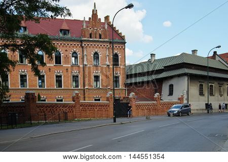 Krakow Poland - August 25 2016: Podzamcze street. On the right side is the House of Dlugosz. Built in the fourteenth century it housed the royal bath. Currently it is the seat of the University Rector of the Pontifical John Paul II in Krakow.