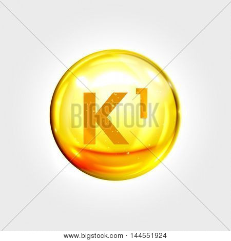 Vitamin K1 gold icon. Phylloquinone vitamin drop pill capsule. Shining golden essence droplet. Beauty treatment nutrition skin care design. Vector illustration.