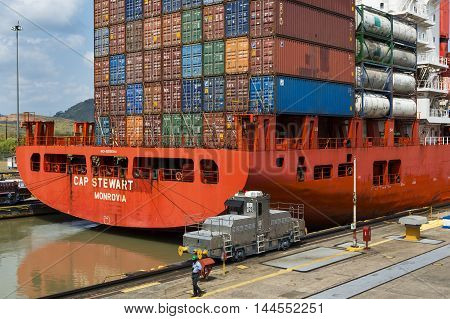 Panama Canal Panama - March 17 2014: Detail of a cargo ship in the Miraflores Locks in the Panama Canal in Panama