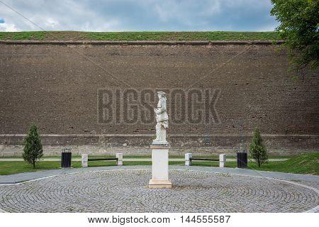 Soldier statue against Walls of Eugen of Savoia Bastion in Citadel of Alba Iulia city in Romania