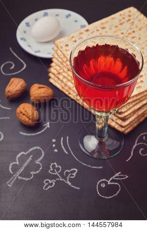Jewish holiday Passover celebration with matzo and wine on chalkboard