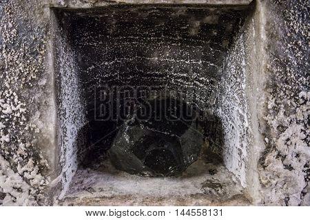 Black stone in Salina Turda salt mine in Turda city in Romania