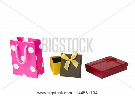 Pink gift packet, red giftbox and yellow brown gift box with ribbon isolated on white background