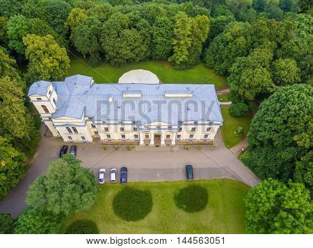 Flat lay, aerial top view of Verkiai palace in Vilnius, Lithuania. Build by architects Marcin Knackfus and Laurynas Gucevicius in the Neoclassical style.