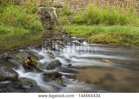 A river rock and culvert dam scenic.