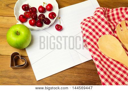 Background for recipy display with blank notebook and fruits. View from above