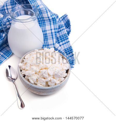 Milk and cottage cheese on white background. Jewish holiday Shavuot concept